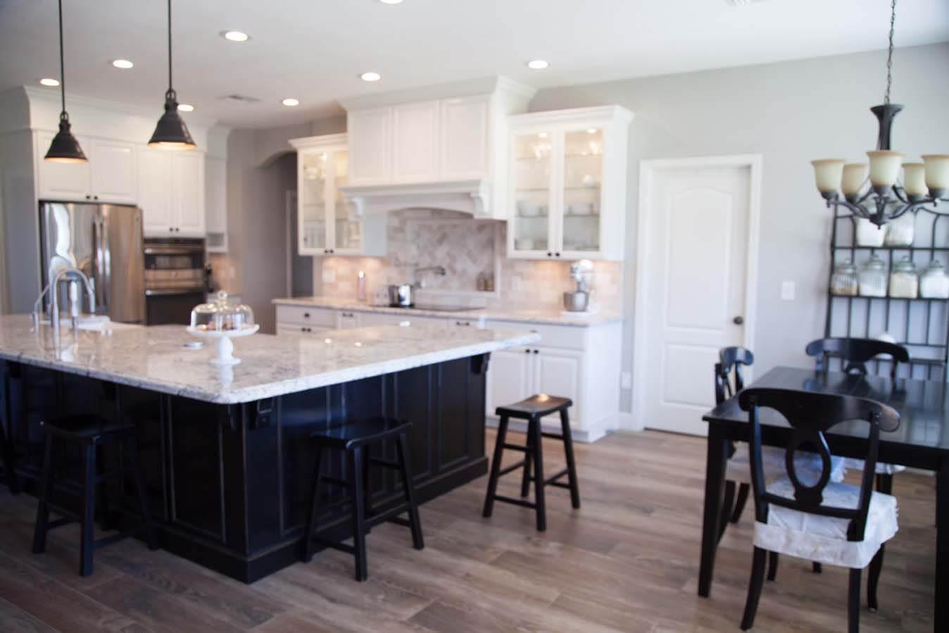 White cabinets dark fixtures remodel